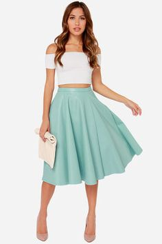 "This is not your grandma's poodle skirt! No, the JOA Sock Hop Light Blue Vegan Leather Midi Skirt takes a modern twist on the pastel midis of old, for an updated look that's perfectly blog-worthy! Beautiful vegan leather falls from a fitted waistline into a full, midi-length skirt with an unfinished hemline. Exposed silver side zipper. Unlined. Model is 5'7"" and wearing a size X-Small. Self: 100% Cotton with 100% Polyurethane coating. Contrast: 100% Polyester. Dry Clean Only. Imported."