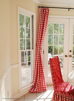 Inexpensive curtain idea - red buffalo check curtains are really tablecloths hung on a curtain rod w/clips found at Target etc.