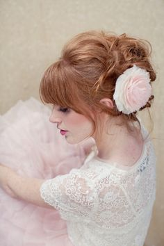 Gorgeous loose upstyle with Pink hair flower