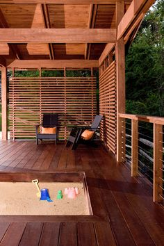 Partially covered deck with privacy screen.