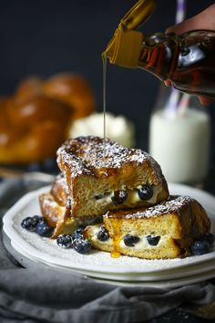 A dollop of tangy mascarpone and a scoop of fresh blueberries is stuffed inside french toast elevating it from good to sublime.