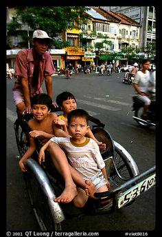 Kids sharing cyclo ride, Ho Chi Minh city. Vietnam