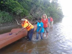 Carrying the dugout canoe