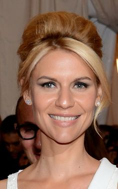 Claire Danes sports a retro updo and diamond stud earrings that seem to go with everything!