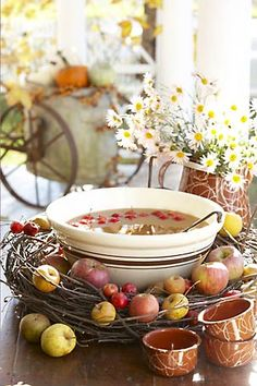 Inspiration: Use a large bowl and sit the bowl in the grapevine wreath,  ( I think I used two) surround with a variety of apples