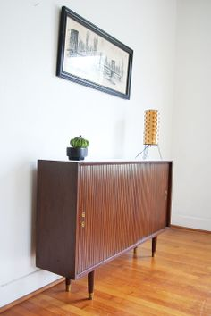 thin profile mid century modern cabinet Modern Cabinets, Cabinet, Furniture, Mid Century Modern Cabinets, Mid Modern, Entry Organization, Home Decor, Media Storage, Record Cabinet