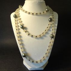Vintage Long Necklace with Glass Glass Beads and Metalic Faux Pearls- 1940's-1950's. $24.00, via Etsy.