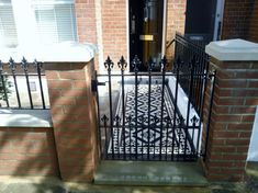 black and white victorian mosaic tile path red brick garden wall wrought iron rail and gate bespoke bin store london (2)