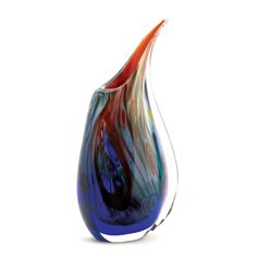 Dreamscape Art Glass Vase All the beguiling colors of a splendid dream are captured in glass for you to enjoy during waking hours. As lovely filled with your favorite blooms as it is alone, let your dreams come to life with this artistic vase. For decorative purposes only. Individually hand-crafted for its unique beauty. Item may be slightly different from the picture shown here.
