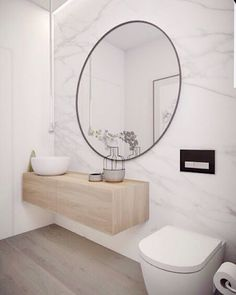 Mirror mirror on the wall who is the fairest of them all? The mirror of course! Our usual kind of bathroom, by yet again the team of @minosa_design. Marble walls, timber vanity and concrete details... What more can you ask for? A statement mirror to finish it all off.