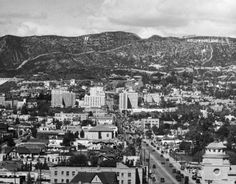Looking north up Vine Street at the Hollywoodland sign and the Hollywood Hills, 1920s.