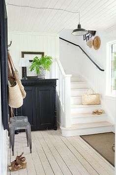 Whitewashed or pickled wood floors and white walls. Interior Architecture, Interior And Exterior, Interior Design, Entry Hallway, Interior Stylist, White Walls, White Stairs, House Colors, Colorful Interiors