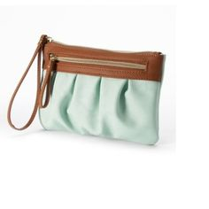 NWT mint and cognac ruched wristlet Adorable!! Great wristlet. Mint and cognac with gold detailing. Snakeskin print on the cognac top of the purse. Two zipped off portions. One on front and one inside. Measures 8x5.5 Apt. 9 Bags Clutches & Wristlets
