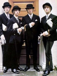 Paul McCartney, Richard Starkey, George Harrison, and John Lennon (fine English gentlemen looking very smart!)