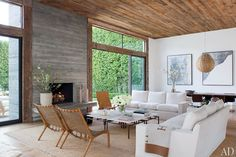 Designer Jenni Kayne's family-friendly Los Angeles living room features a board-formed concrete fireplace and a salvaged-pine ceiling.