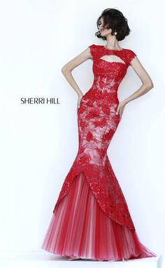 SHERRI HILL Prom Dresses 2015 # 11232 Lace appliqués, are beautifully and strategically placed on this sheer lace, cap sleeve gown, then re-embroidered with beads and sequins. The hourglass silhouette is emphasized with a pleated tulle underskirt and topped with a keyhole neckline and back.