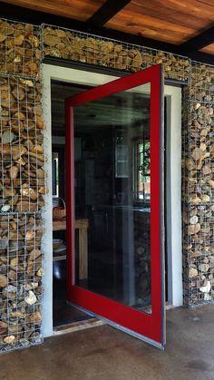 We LOVE this custom red pivoting Pella entry door.