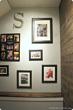 A matching frames gallery and wood planked wall