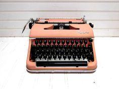 Vintage Typewriter Pink Olympia SM 3 Deluxe Manual Typewriter. $240.00, via Etsy.