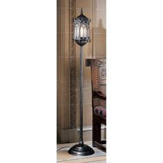 In medieval times, metalworkers created handsome Gothic lanterns like this Toscano exclusive. Shed your own light with our sculptural metal and cast designer resin filigree lamp fitted with glass panels. Standing nearly six feet tall, this lamp is a columnar masterpiece blending art, architecture, and the elements of fine décor.