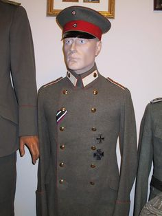 Imperial German officer's WWI uniform tunic and cap.
