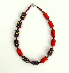 Asymmetrical red and brown polka dot fiber necklace
