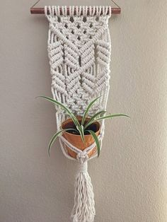 Handmade in sunny San Diego, CA from 100% cotton rope and copper hollow rod. Pot and plant not included. Copper rod measures: 10 inches Macrame is: 25 in x 7 in