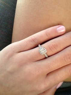 Engagement ring, princess cut halo? Not sure but it's the perfect size not too big not too small!
