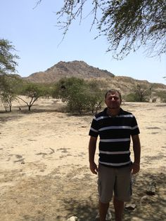 In front of what appears to be a large hill, but in reality it is a Pyramid...
