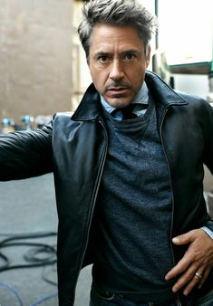 Robert Downey Jr with a fall business casual combo with a black leather jacket gray crewneck sweatshirt denim button up shirt navy knit tie Sweat Shirt, Crew Neck Sweatshirt, Robert Downey Jr., Iron Man Tony Stark, Herren Outfit, Downey Junior, Hollywood Actor, Gentleman Style, Bleu Marine