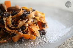carrot noodles with poppy seeds and almonds