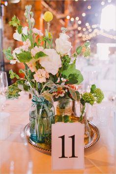 assorted floral arrangement centerpiece #weddingreception #centerpiece #weddingchicks http://www.weddingchicks.com/2014/03/17/central-coast-summer-wedding/