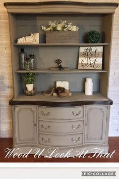 China Cabinet repurposed as a bookshelf. Removed the front doors and glass. Finished in French linen, clear and black wax. Hardware updated with silver gilding