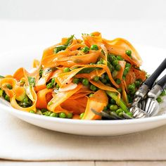 Sliced fresh carrots and green onions add garden-fresh flavor to this salad, while frozen peas and a homemade honey vinaigrette keep prep quick and easy: http://www.bhg.com/recipes/salads/ideas/garden-fresh-salads/?socsrc=bhgpin011114carrotribbonsalad&page=12