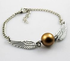 Harry potter Golden Snitch Bracelet, Silver Double sided wings. $1.99, via Etsy.