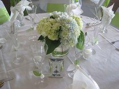 Simple, elegant centerpiece of hydrangeas, created by Floribunda Designs.