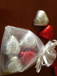 This bride put her Kisses stickers on little chocolate hearts and placed them in an organza bag for their guests. So cute!