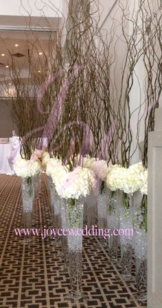 #Tall #centerpieces is #grand and #classy, it gives the #royal #theme to a #wedding. Using #fresh #flower #white #hydrangeas, #tall #vase and #real #tree #branches gives the #elegant #feel that every #bride wants.