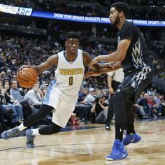 photo - Denver Nuggets guard Emmanuel Mudiay, left, tries to drive to the basket as Minnesota Timberwolves center Karl-Anthony Towns defends during the first half of an NBA basketball game Friday, Oct. 30, 2015, in Denver. (AP Photo/David Zalubowski)