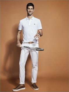 Wearing all white, Novak Djokovic fronts Lacoste's advertising campaign.