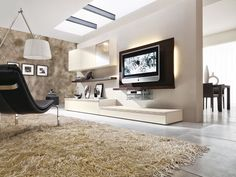 Living room composition 530 from modular collection Sistema 302. Particular shape of wall units and shelve, which can be combined depending on the space possibilities and requirements. TV panel has stylish background lighting and a shelve which follows the game of shapes, set by the wall units. All in oak verneer.