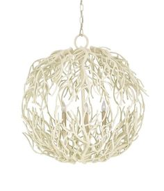 Reminiscent of the spindly roots of the Mangrove tree, the Eventide Sphere Chandelier's delicate shape allows the lights within to shine through, providing an ethereal glow.