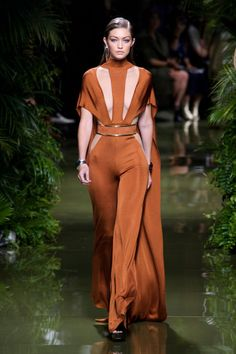 Welcome to the jungle. Everything about Olivier Rousteing's spring Balmain presentation was a study in how to live the lush life—from the verdant greenery of the hanging plants and runway to the abundant curves of his models.