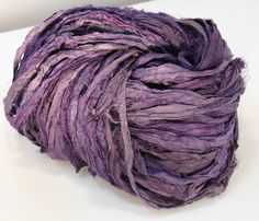 Recycled sari yarn  http://store.darngoodyarn.com/collections/yarn/products/muted-purple-recycled-silk-sari-ribbon-yarn-100g