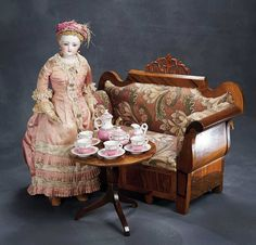 French doll with her accessories