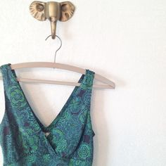 Floral Silk Tank Beautiful silk tank with green and turquoise floral pattern on navy blue background. Great condition. 100% silk. Size S Old Navy Tops Tank Tops