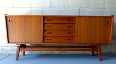 Exceptional mid century Modern credenza / media stand. Perfect layout for a media stand - generous shelving for components paired with streamlined drawers for r