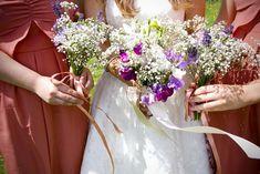 Small Bridesmaids bouquets of sweet pea, lavender, gypsophila.