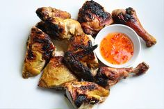 southern-style thai grilled chicken w/ whole chicken, garlic, white peppercorns, cilantro roots or stems, ground tumeric, thai fish sauce, oyster sauce & coconut palm sugar or brown sugar