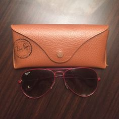 Ray-Ban Aviators These very lightly worn pink framed, classic style Ray-Ban Aviators are in great condition and come with the case and cleaning cloth! Ray-Ban Accessories Sunglasses